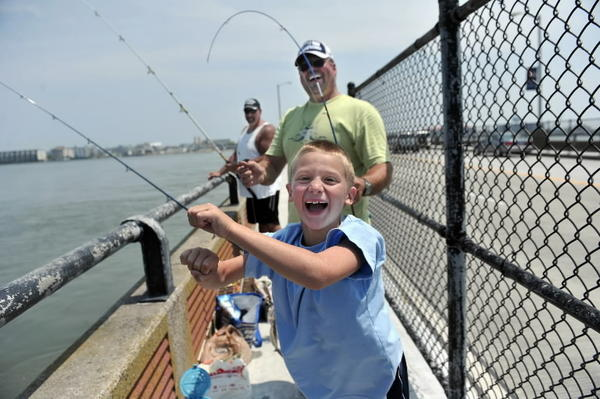 Fishing for flounder on U.S. 50 bridge to Ocean City. NOAA's fisheries service has declared the Mid-Atlantic's summer flounder stock rebuilt