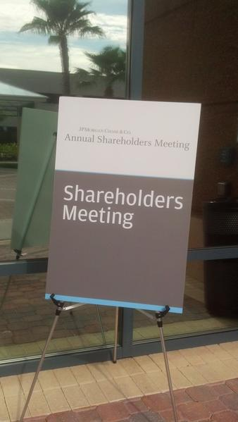 The annual meeting is the first time JPMorgan board members will face shareholders since disclosing a stunning $2-billion loss due to complicated derivatives trades.