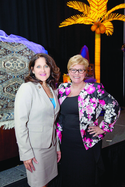 "Terri Wallace, left, and Cindy Schutt at Leadership Broward Foundation's 20th annual ""Fun Lunch,"" which took place on April 25 at the Signature Grand located in Davie."