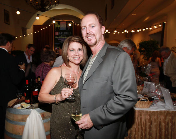 "Annette Coleman, left, and Rod Coleman at the ""American Fine Wine Competition,"" which celebrated its fifth anniversary with a gala dinner at the Boca Raton Resort & Club and featured Chef Emeril Lagasse. The event raised more than $60,000 for the Diabetes Research Institute and Golden Bell Education Foundation."
