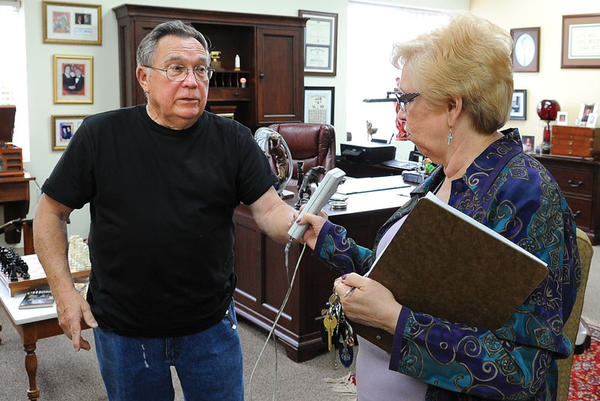 Rankin Paynter, left, purchased the remaining inventory of Kmart after the store closed May 6. Here, he talks with Judy Crowe, executive director of Clark County Community Services, who is sorting through the donations. Many of the coats will go to Operation Happiness in December.