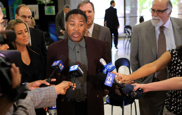 Surrounded by his attorneys, Bennie Starks speaks to the media after his court case was dismissed in the Lake County Courthouse in Waukegan today.
