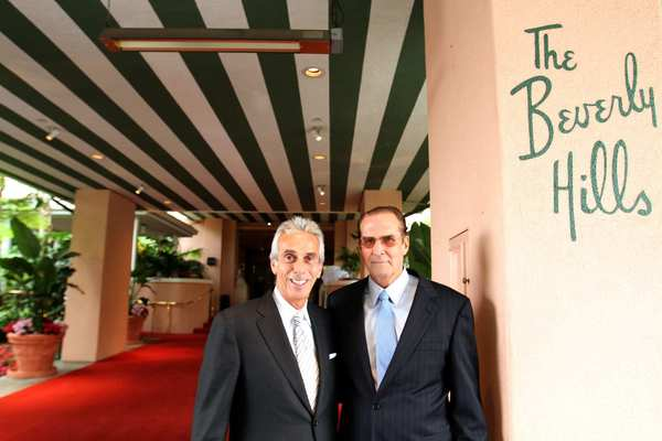 "General manager Edward Mady, left, and Beverly Hills Hotel historian Robert S. Anderson, the great-grandson of the hotel's original owner, Margaret Anderson, is releasing a book titled ""The Beverly Hills Hotel and Bungalows: The First 100 Years."""