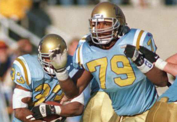 Jonathan Ogden, right, opens up a hole for Karim Andul-Jabbar while with the Bruins in 1995.