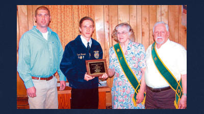 Ryan Horner, second from the left, is shown receiving Somerset County's 2012 Outstanding FFA Student award plaque from the Somerset County Pomona Grange. From left: Rob Harrold, the honoree's forestry instructor and FFA adviser at the Somerset County Technology Center; Horner; Nancy Boucher, Pomona Grange's youth committee chairperson, and Jim Mowry, Master of the Somerset County Pomona Grange. This was Pomona Grange's 56th annual presentation of the Outstanding FFA Student Award.