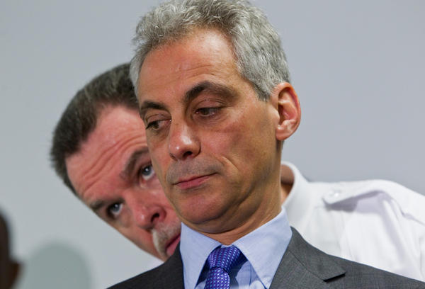Mayor Rahm Emanuel listens to Police Superintendent Garry McCarthy before making an announcement about a new public safety strategy at the St. John Missionary Baptist Church in Chicago on Tuesday.