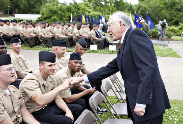 Secretary of the Interior Ken Salazar, right, greets Navy Seaman Kyle Crout during a ceremony Tuesday at the Yorktown Victory Monument at the Colonial National Historical Park in Yorktown. Salazar announced the creation of a free annual pass for active duty military members that allows access to more than 2,000 public lands.