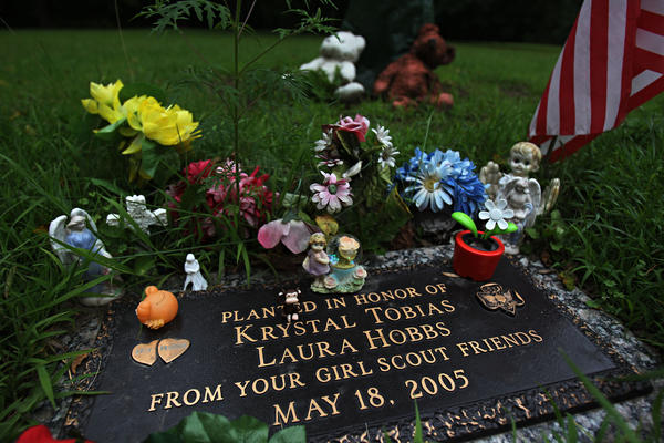 A memorial to Krystal Tobias and Laura Hobbs stands in Beulah Park in Zion in 2011.