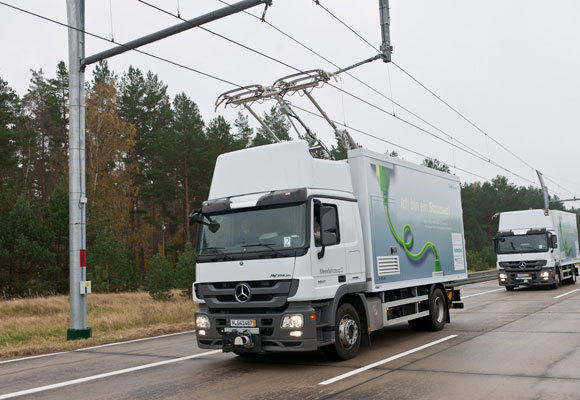 Trucks travel along a test track in Germany, where Siemens is working on its eHighway concept, which runs diesel hybrid trucks on overhead electric wires. This system has been proposed to cut pollution on Interstate 710 in L.A.