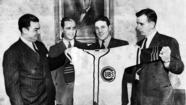 1942: Cubs players show off their new uniforms