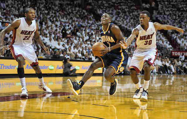 Indiana Pacers guard Darren Collison easily gets past Miami Heat guard Norris Cole during the second quarter of their Round 2, Game 2 playoff game, Tuesday, May 15, 2012, at AmericanAirlines Arena.