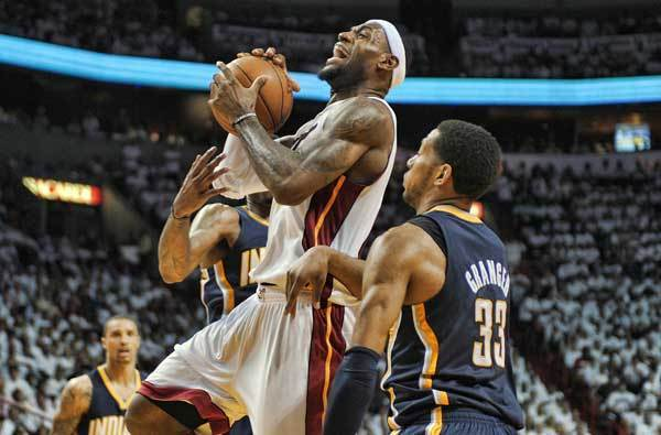 Miami Heat forward LeBron James drives to the basket through the Indiana Pacers defense during the third quarter of their Round 2, Game 2 playoff game, Tuesday, May 15, 2012, at AmericanAirlines Arena.