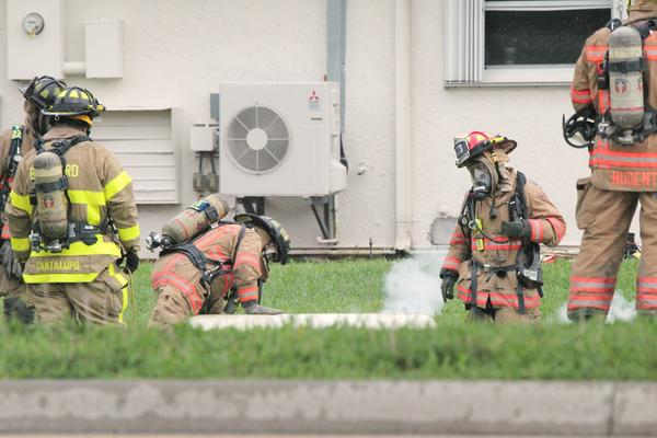 Firefighters trace a propane gas leak to a tank outside their own fire station in Deerfield Beach