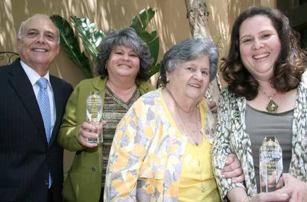 Glendale Mayor Frank Quintero lauds two Jewels of Glendale and their mother, from left, Betty Porto, mother Rosa Porto and Margarita Navarro.