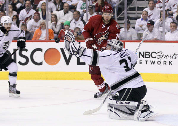 Kings goalie Jonathan Quick makes a glove save during his 4-0 shutout of the Coyotes.
