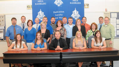 Five Windber athletes announced their intentions to play sports at the collegiate level Tuesday. Front row from left are: Kayla Kormanik, Leah Brutz, Shane Fleegle, Cheyenne Feathers and Brooke Schreyer; middle row: parents Steve and Nancy Kormanik, Kelly and John Brutz, Paul and Kelly Fleegle, Mike and Kathleen Feathers and Christine and Mike Schreyer; back row: coaches Cory Pavlosky, Don Byer, Matt Grohal and Joe Podrebarac and athletic director Bill Jablon.