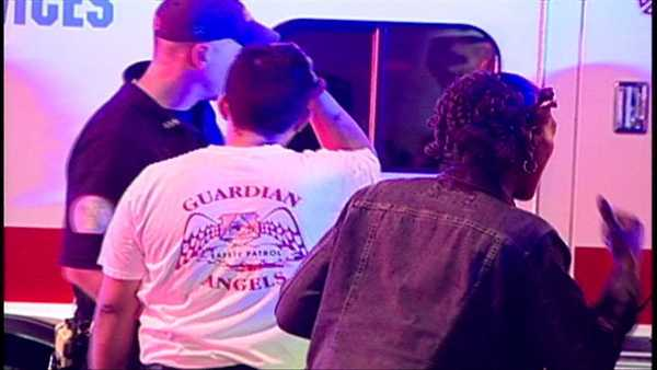 Emergency officials at the scene of a stabbing involving four Guardian Angels.