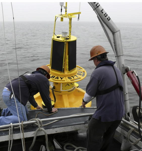 Crew deploying 'smart' buoy at mouth of Patapsco River to mark Captain John Smith Chesapeake National Historic Trail.