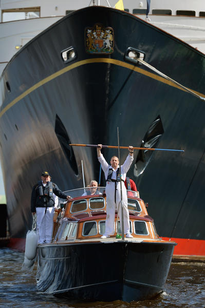 Yottie Billy Sutherland practises a ceremonial drill on Britannia's Royal Barge on May 16, 2012 in Edinburgh, Scotland. The Royal Barge is to play a key role in the Diamond Jubilee Thames Pageant in June, carrying Queen Elizabeth II and Prince Philip.