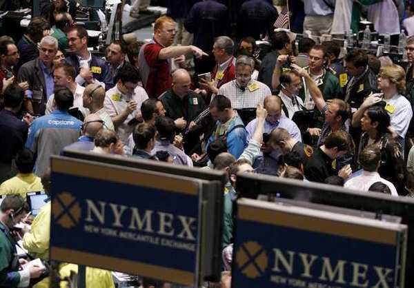 Crude oil future traders work on the floor of the New York Mercantile Exchange in New York.