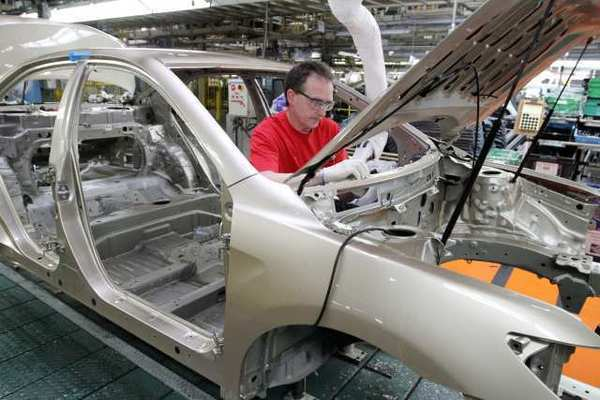 Industrial production, led by autos, grew at its fastest pace in more than a year