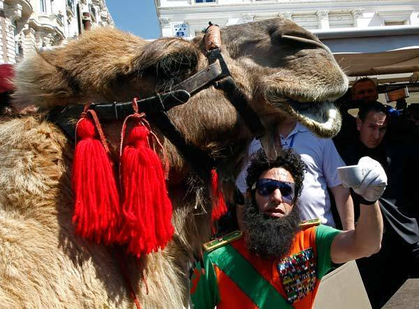 "Sacha Baron Cohen stands next to a camel during a photocall on the Croisette for his latest movie ""The Dictator"", in Cannes."