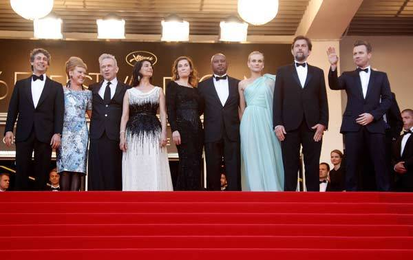 "Jury members of the 65th Cannes Film Festival (L to R) Alexander Payne, Andrea Arnold, Jean-Paul Gaultier, Hiam Abbass, Emmanuelle Devos, Raoul Peck, Diane Kruger, Nanni Moretti and Ewan McGregor arrive on the red carpet for the screening of the film ""Moonrise Kingdom"" by Wes Anderson."