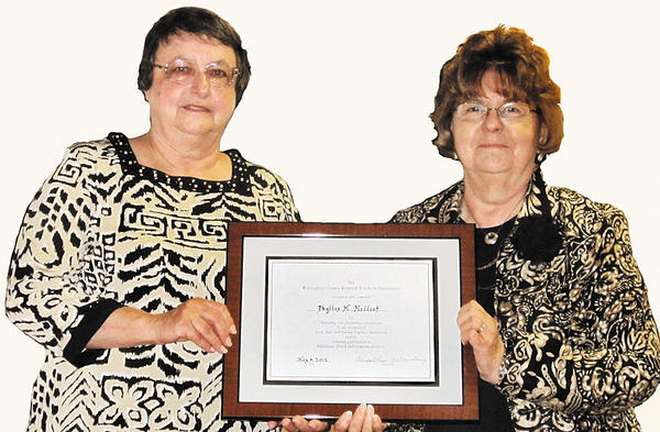 From left, Phyllis McCleaf and Polly Martin, chairwoman of the Washington County Retired Educational Association awards committee.