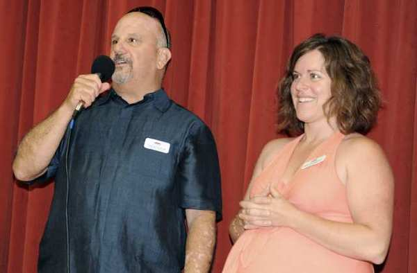 Former Board Member President Tom Reynolds, left, and former executive director Megan Nordvedt, right, welcome and thank community members for attending and participating in the Fabulous CCLCF Casino Night at Community Center of La Canada Flintridge.