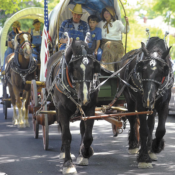 Norman Mason, grandson Brandon and wife Peggy Mason lead the National Pike Festival during last years event. For the first part of their ride they had a stowaway  a Herald-Mail editor.