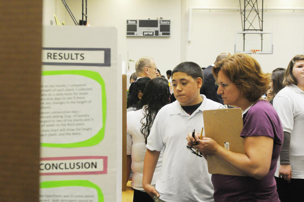 Julio Oyola, 13, whose project was Mold Attack, with judge Shirley Murrant, a volunteer from Hartford Hospital during the judging of the 21st annual city-wide science fair held at Annie Fisher School Wednesday.