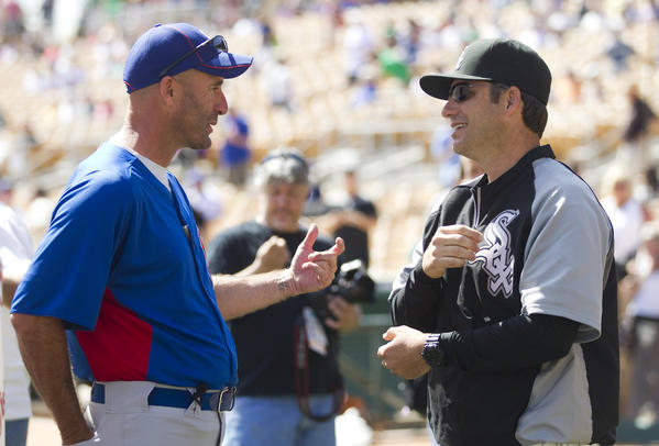 Managers Dale Sveum and Robin Ventura before a Cactus League spring training game.