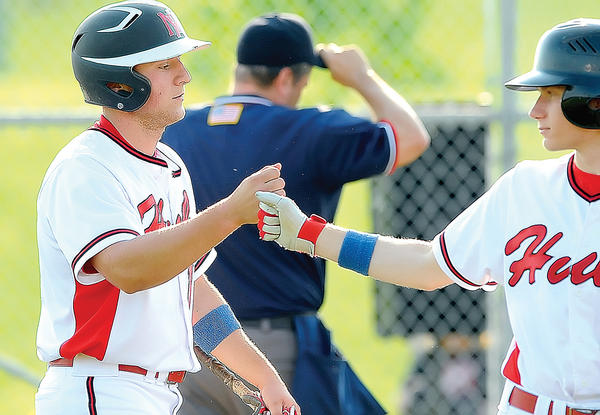 North Hagerstown's Alex Courtney, left, gets a congratulatory fist bump from teammate Hunter Williams after driving in a run in the bottom of the second inning on Wednesday in the Hubs' 11-0 win over Northwood in the Maryland 3A West quarterfinals. Courtney had three hits, including a home run.