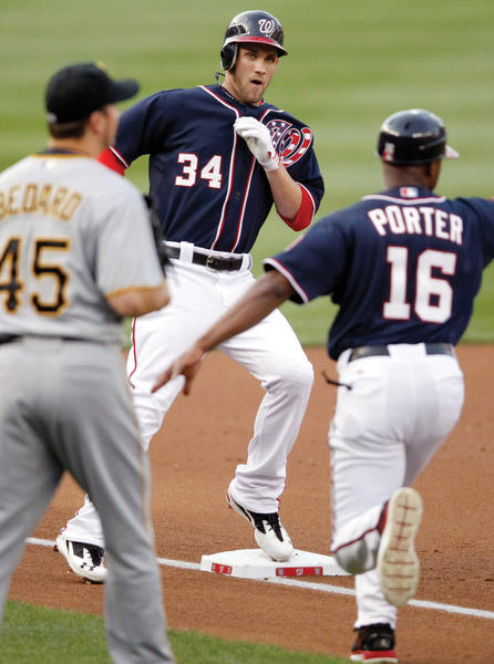 Washington left fielder Bryce Harper (34) looks for directions from Nationals third base coach Bo Porter (16) after hitting a triple.  to deep right during the first inning of a baseball game against the Pittsburgh Pirates, Wednesday, May 16, 2012, in Washington. (AP Photo/Haraz N. Ghanbari)