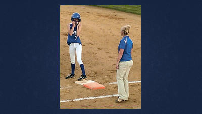 Berlin pinch runner Marissa Vance listens as head coach Ashley Shaffer works on strategy in the seventh inning.