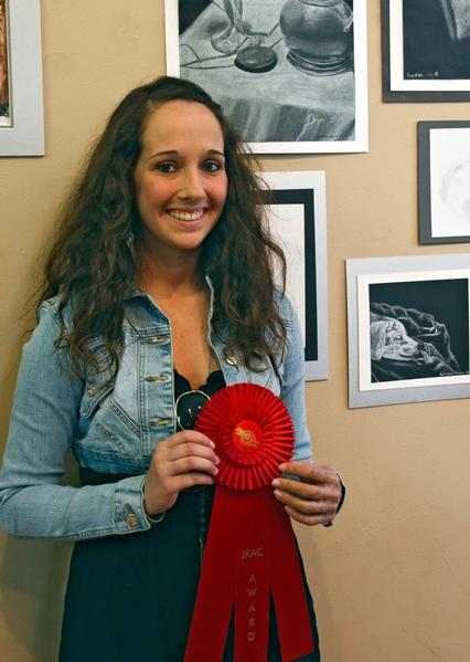 Kiersten Clavier wins the JRAC Award in the Jordan River Arts Council's Scholarship Show.