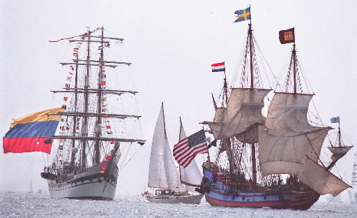 Two majestic tall ships, Simon Bolivar of Venezuela, left, and Kalmar Nyckel from the United States, right, make their way along the route during the OpSail 2000 Parade of Sail on June 16, 2000.