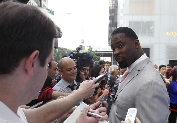 Giants defensive end Justin Tuck talks to the media at the Super Bowl ring ceremony at Tiffanys in New York.