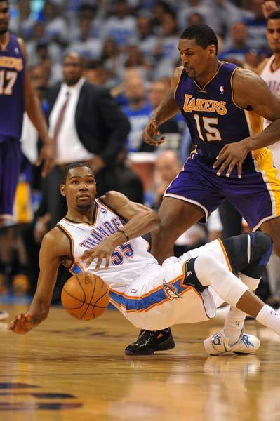 Oklahoma City Thunder forward Kevin Durant (35) is fouled by Los Angeles Lakers forward Metta World Peace (15) during the second half in game two of the Western Conference semifinals of the 2012 NBA Playoffs at Chesapeake Energy Arena.