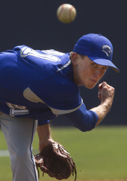 Bryan Bierlein of CNU eyes his throw to home plate Thursday during action against Lynchburg College during the 2012 NCAA Division III Baseball Tournament Thursday.