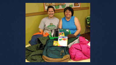 "Laurel Trinity Lutheran Church in Jennerstown is conducting a clothing, book bag and school supplies drive to help needy children in the North Star and Conemaugh Township School Districts. Shown helping with this year's annual community service project are Jodi Sullivan and her mother, Sue Berkey. Donations of new and ""gently"" used coats, hats, boots, gloves, and more may be dropped off at the church. For more information, contact Sullivan at the church at 814-629-9288."