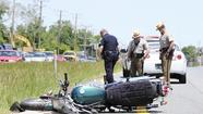 Motorcyclist injured in crash Thursday remains in hospital