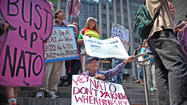 About 75 protesters marched Thursday afternoon from President Barack Obama's re-election headquarters to three consulates of countries that belong to NATO, protesting the alliance's involvement in the war in Afghanistan and other military action.
