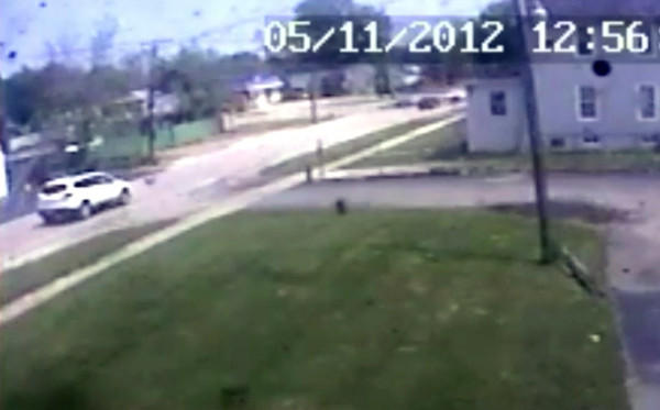 Still photograph from surveillance video showing an SUV involved in a hit-and-run crash that fatally injured an Aurora motorcyclist.