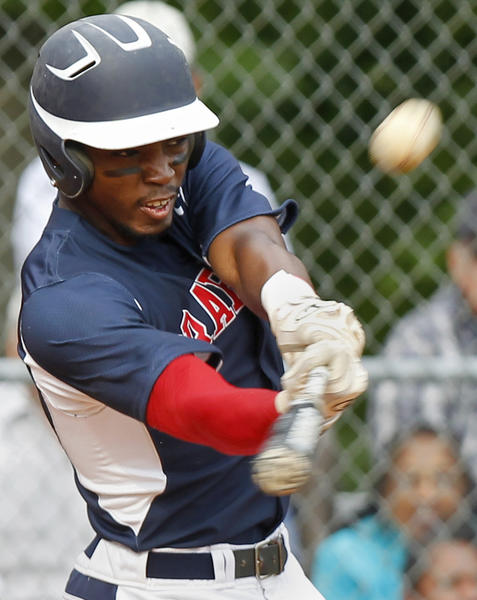 Grafton's Kyri Washington hits a home run during the third inning of Thursday's game against York.