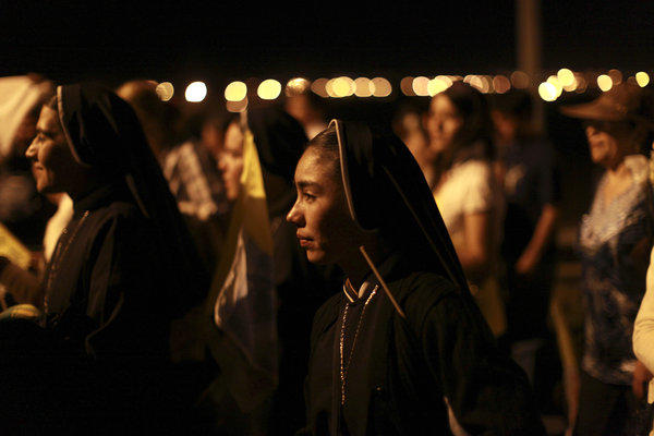 Nuns walk alongside pilgrims as they travel up a road to the site where Pope Benedict XVI gave Mass at the Bicentennial Park near Silao, Mexico.