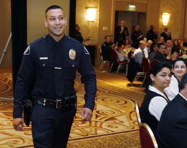 Glendale Officer Jeff Rivas walks to accept the Officer of the Year Award at the 17th Annual Glendale Police Awards Luncheon at the Glendale Hilton.