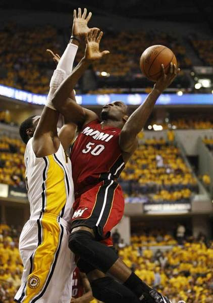 Miami Heat center Joel Anthony (50) puts up a shot defended by Indiana Pacers center Roy Hibbert during the second quarter of Game 3 of their NBA Eastern Conference second round basketball playoff series in Indianapolis May 17, 2012.