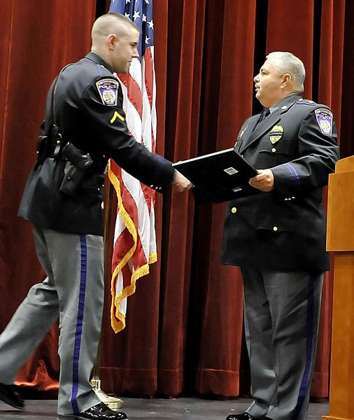 Smithsburg Police Officer Matt Hudson,left, receives an award of merit from Smithsburg Chief George Knight at the Public Safety Awards ceremony.