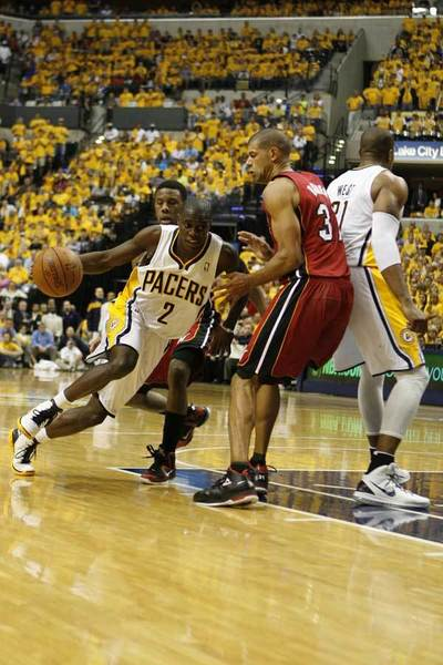 May 17, 2012; Indianapolis, IN, USA; Indiana Pacers guard Darren Collison (2) drives to the basket against  Miami Heat  forward Shane Battier (31) at Bankers Life Fieldhouse. Indiana defeats Miami 94-75.